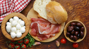 Italian food - olives, parma ham, tomatoes, mozzarella Stock Photo