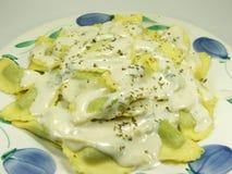 Italian Food. Pasta. Fresh italian pasta called mezzelune with cheese sauce stock photos