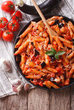 Italian food: Pasta alla Norma close-up and ingredients. vertica Royalty Free Stock Photography