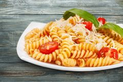 Italian food. Pasta fusilli ricotta dish parmesan cherry tomatoes Royalty Free Stock Photos