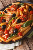 Italian Food: Pasta with meatballs, olives and tomato sauce clos Stock Photography