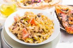 Italian food pasta and pizza Royalty Free Stock Image