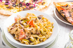 Italian food pasta and pizza Stock Images