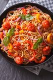 Italian food: pasta with vegetables closeup. vertical top view Stock Image