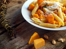 Italian food - Penne pasta with pumpkin Royalty Free Stock Images