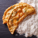 Italian food: pizza calzone and flour close-up. top view Royalty Free Stock Photo
