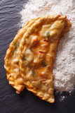 Italian food: pizza calzone and flour close-up. vertical top vie Stock Images