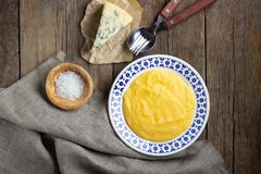 Italian food polenta with cheese gorgonzola on wooden table. stock photos