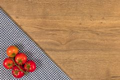 Italian food and raw ingredients on wooden background. Top view. Italian food ingredients and checkered napkin on wooden table. Top view with space for your text Stock Image