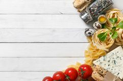 Italian food recipe on rustic wood. Overhead view of ingredients for an Italian pasta recipe on rustic wood background Royalty Free Stock Photo