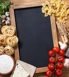 Italian food recipe on rustic wood. Overhead view of ingredients for an Italian pasta recipe on rustic wood background Stock Images