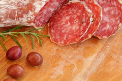 Italian food - salami, rosemary, olives Royalty Free Stock Photos