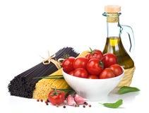 Italian food  - spaghetti, tomatoes, basil, olive oil Stock Photos
