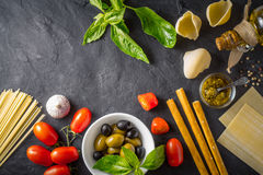 Italian food still life on the dark table top view Stock Images