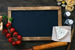 Italian food on vintage wood background Royalty Free Stock Photos