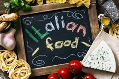 Italian food on vintage wood background Royalty Free Stock Photo