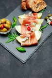 Italian Food With Melon And Prosciutto On Stone Board Royalty Free Stock Photo