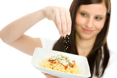 Italian food - woman spaghetti grated cheese sauce Royalty Free Stock Image