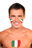 Italian football fan. Portrait of an italian football fan with flag on his body and face, isolated on white royalty free stock photo