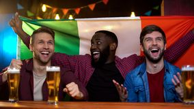 Italian football fans celebrating football team victory, watching game in bar. Stock photo stock photo