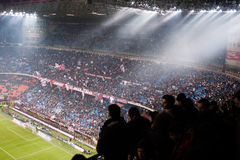 Italian football supporters at the stadium. MILAN, FEBRUARY 26: AC Milan supporters watching the game during the Italian Championship soccer game, AC Milan Royalty Free Stock Photography