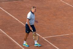 Italian former football player Marco Tardelli playing tennis stock images