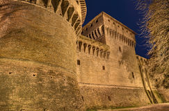 Italian fortress. Detail of medieval castle of Caterina Sforza at night, old fortress in Forli, Emilia Romagna, Italy Royalty Free Stock Photo