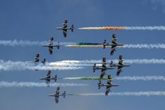 Italian Frecce Tricolori air acrobatics planes engaged in a head-on pass. Royalty Free Stock Photos