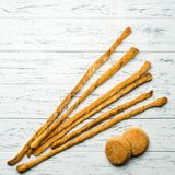 Italian fresh baked Grissini bread sticks on light wooden backgr. Ound, top view. Traditional Italian snack royalty free stock photos