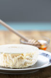 Italian fresh goat cheese and honey Royalty Free Stock Photography