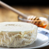Italian fresh goat cheese and honey Royalty Free Stock Photos