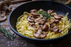 Italian fresh pasta. Fresh egg tagliatelle italian homemade pasta with mushrooms Stock Photography