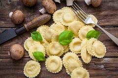 Italian fresh pasta. Italian homemade ravioli style stuffed with cheese and portobello mushrooms Royalty Free Stock Photo