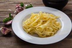 Italian fresh pasta. Preparing a dish of italian pesto pasta on plate Royalty Free Stock Photos