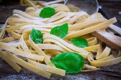 Italian fresh pasta. Preparing fresh potato tagliatelle on wood board Stock Image