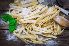 Italian fresh pasta. Preparing fresh potato tagliatelle on wood board Stock Images