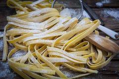 Italian fresh pasta. Preparing fresh potato tagliatelle on wood board Royalty Free Stock Photo