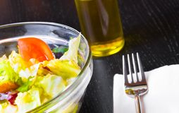Italian fresh salad and tomato on wood restaurant table Royalty Free Stock Images