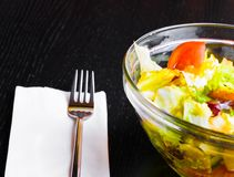 Italian fresh salad and tomato on wood restaurant table Royalty Free Stock Photography