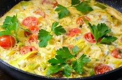 Italian Frittata in iron pan. Stock Photo