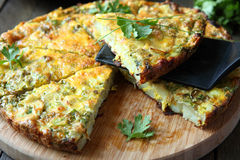 Italian Frittata with slices of fresh greens. Food royalty free stock image