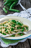 Italian Fusilli pasta with green peas Stock Images