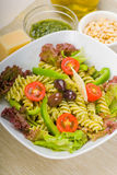 Italian fusilli pasta salad. Fresh healthy homemade italian fusilli pasta salad with parmesan cheese,pachino cherry tomatoes, black olives and mix vegetables royalty free stock photos