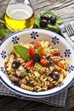 Italian Fusilli pasta with swordfish royalty free stock photos