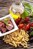 Italian Fusilli pasta with swordfish ingredients Stock Image