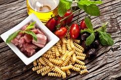 Italian Fusilli pasta with swordfish ingredients Royalty Free Stock Photography