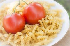 Italian fusilli pasta with tomatoes Royalty Free Stock Photos
