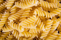 Italian Fusilli, Rotini or Scroodle Macaroni Pasta food background texture Stock Image