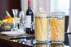 Italian Fusilli or Rotini helix shaped Macaroni Pasta  and spagh Stock Photos