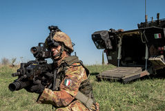Italian future soldier project. With the Beretta Arx160 rifle in the hand and near an Freccia tactical tank. the modern warfare Stock Image